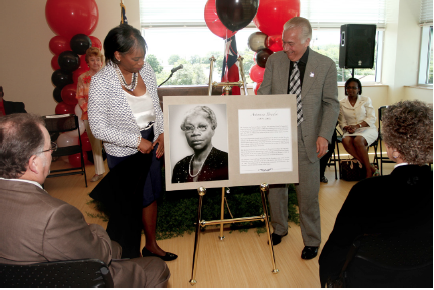UIW President Dr. Louis J. Agnese, Jr., and Dr. Adena Williams Loston, President, St. Philip's College, unveil a plaque dedicated to community leader Artemisia Bowden.