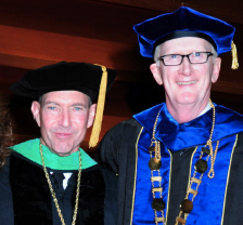 Salus' Dr. Lewis Passes Presidency to His Successor