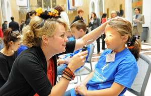 Dr. Kara Gerger, Pediatric Resident at NECO, conducts a vision screening during Children's Vision Advocacy Day at the Massachusetts State House. (Frank Curran Photography)