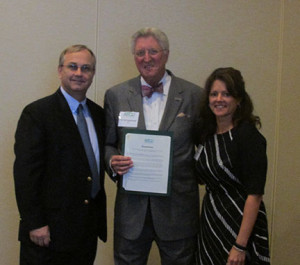 Dr. Arol Augsburger (center, pictured with Dr. Jennifer Coyle and Dr. Larry Davis) accepts the resolution congratulating him on his induction into the National Optometry Hall of Fame.