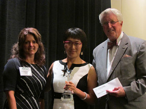 Dr. Yi Pang receives the Rising Star Award from Dr. Jennifer Coyle and Dr. Arol Augsburger during ASCO's Leadership Luncheon in Philadelphia in June.