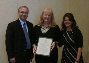 At its annual meeting in June, the ASCO Board of Directors presented Dr. Karla Zadnik (center) with two Resolutions, one congratulating The Ohio State University College of Optometry on its 100th anniversary and one honoring her upon her induction into the National Optometry Hall of Fame. Dr. Zadnik is pictured with ASCO President Dr. Jennifer Coyle and Dr. Larry Davis, Dean, University of Missouri-St. Louis College of Optometry.