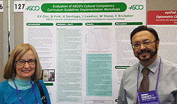Dr. Barbara Fink and Dr. Hector Santiago with the subcommittee's AAO poster.