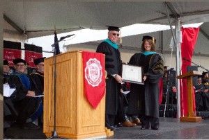 Dr. Doug Weberling receives the 2016 Kamelia Massih Prize for a Distinguished Optometrist from PUCO Dean Dr. Jennifer Coyle during the college's professional programs commencement ceremony on May 21, 2016.
